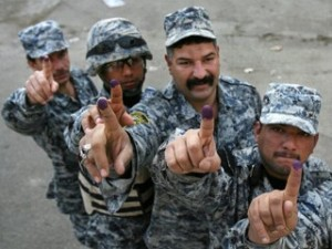 Iraqi policemen hold up their ink-stained fingers after casting their vote in the country's provincial elections in Baghdad, Iraq, Wednesday, Jan. 28, 2009. The polls opened Wednesday for members of the Iraqi security forces, detainees and hospital patients. General voting is scheduled on Saturday. (Hadi Mizban/AP Photo), courtesy of ABC News.